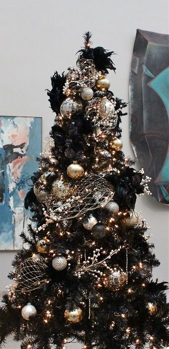 02-a-black-Christmas-tree-decorated-in-gold-and-silver-for-a-chic-gothic-inspired-look