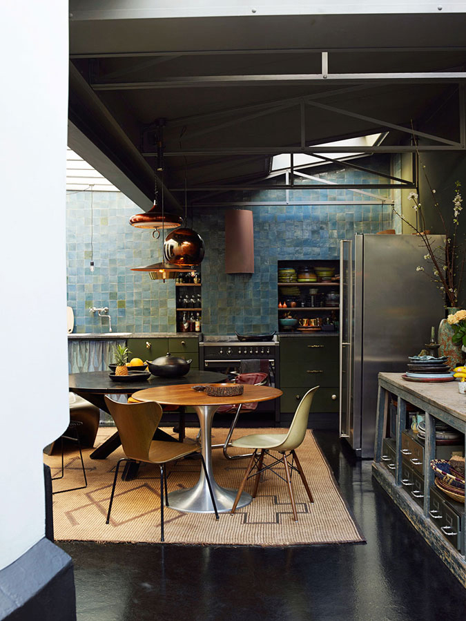 03-The-moody-kitchen-is-done-with-an-industrial-vibe-the-blue-and-green-tiles-rule-the-space