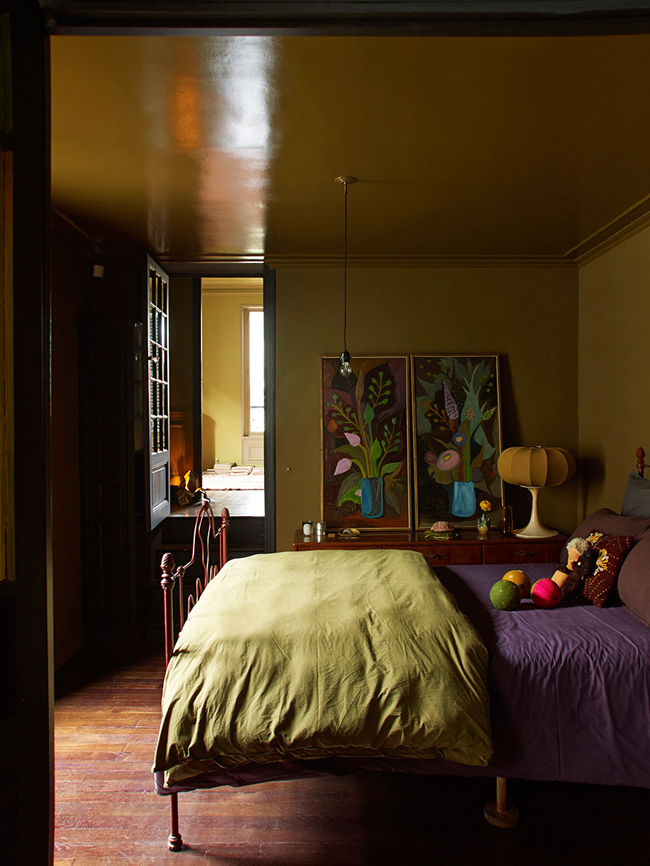 05-The-master-bedroom-is-done-in-ocher-and-spruced-up-with-bold-artworks-from-the-owners-collection