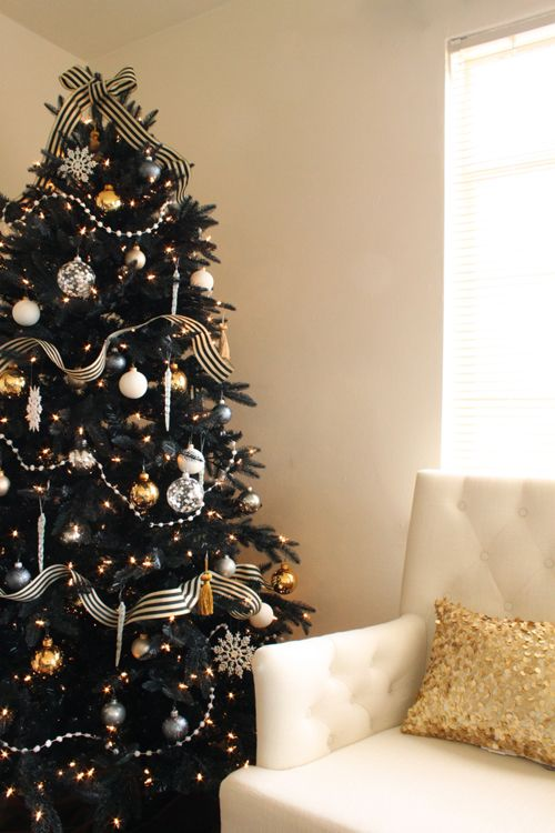 05-refined-black-Christmas-tree-with-striped-ribbon-silver-and-gold-ornaments