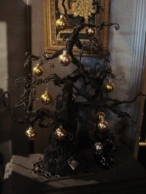 06-Gothic-black-Christmas-tree-with-gold-ornaments-for-a-spooky-holiday