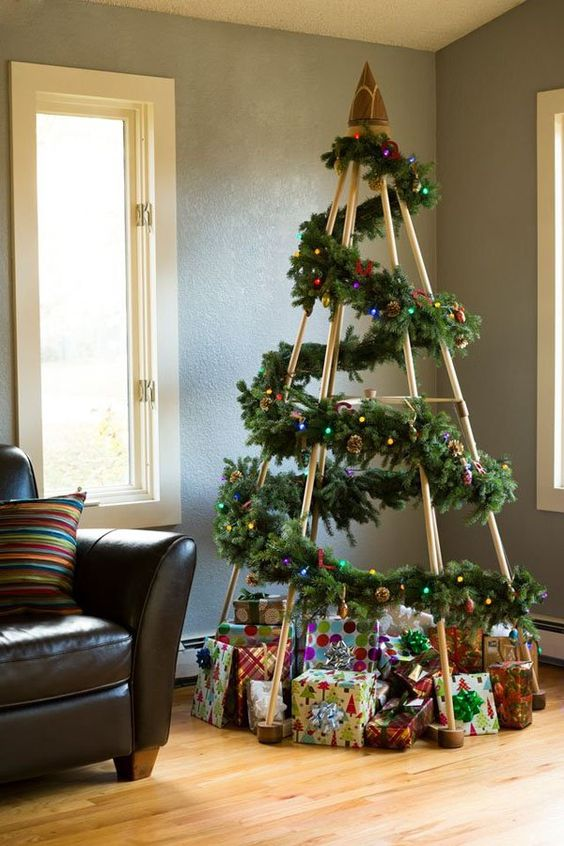 22-modern-take-on-a-traditional-Christmas-tree-made-of-a-frame-and-a-fir-garland-over-it