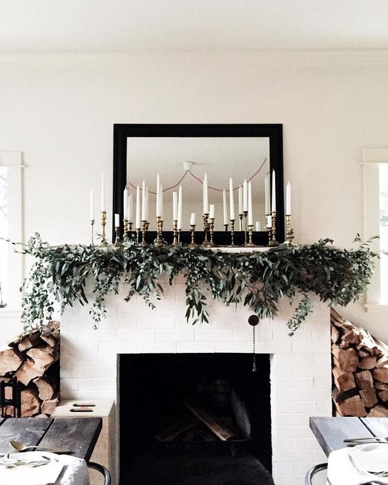 29-a-greenery-garland-with-lots-of-candles-over-the-mantel