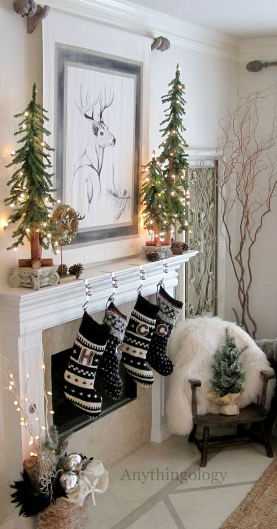 30-black-and-white-stockings-and-lit-up-small-trees-on-the-mantel