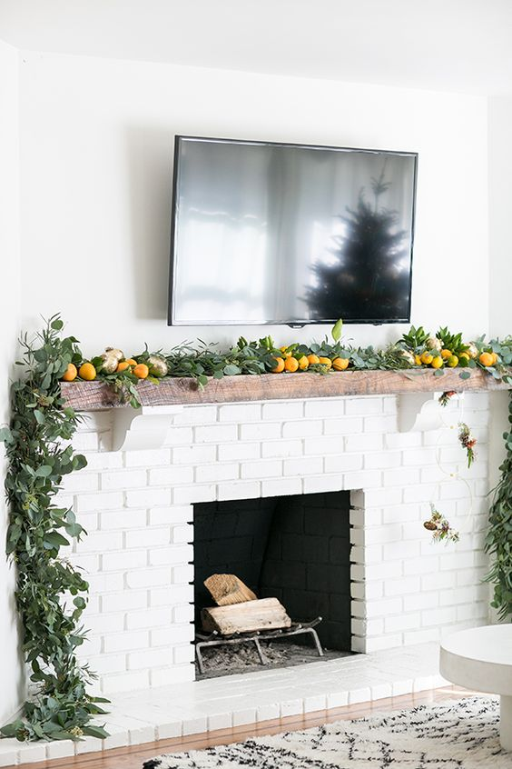 31-citrus-and-greenery-garland-to-cover-a-mantel-is-a-chic-modern-idea