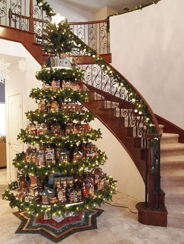 33-gingerbread-houses-on-stands-covered-with-evergreens-and-garlands