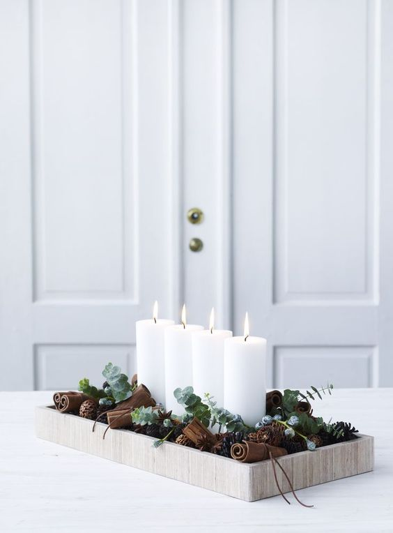 42-modern-Christmas-display-in-a-wooden-tray-with-cinnamon-sticks-eucalyptus-and-candles