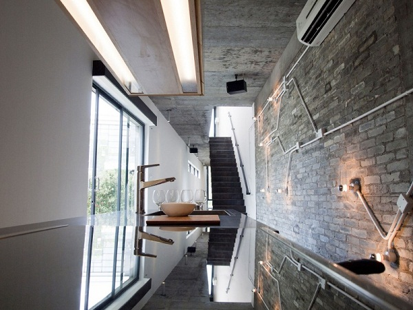 contemporary-kitchen-design-brick-wall-Tapered-House