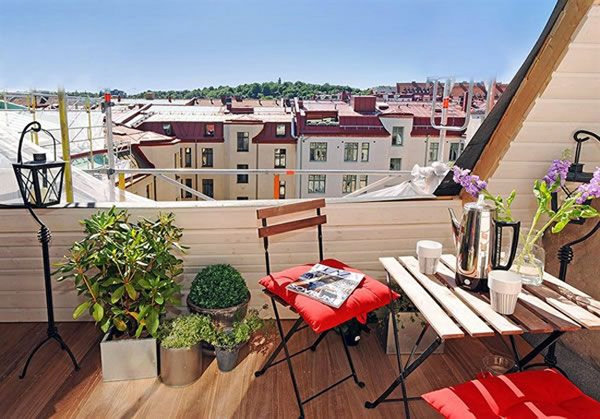 Elegant-balcony-design-folding-chairs-and-table-red-accents-potted-plants