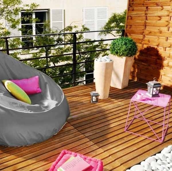 Small-balcony-design-ideas-large-armchair-modern-planters-small-coffee-table