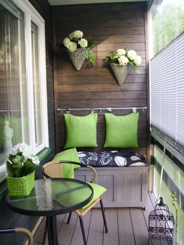 balcony-decorating-with-plants-bench-green-pillows