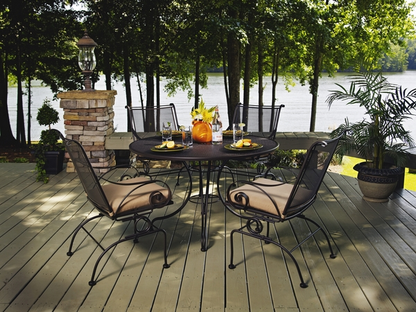 contemporary-patio-design-wooden-deck-wrought-iron-furniture-round-table