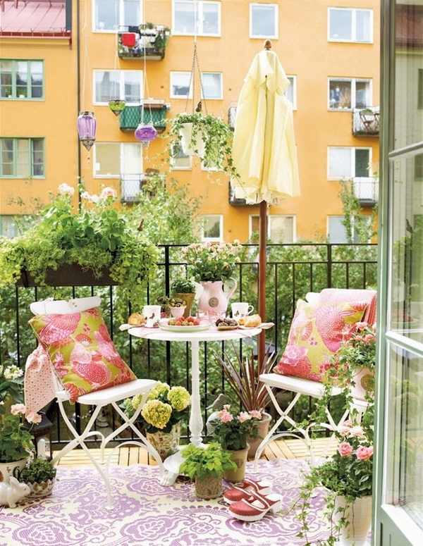small-balcony-decoration-ideas-cofee-table-chairs-colorful-pillows-flowers-in-pots