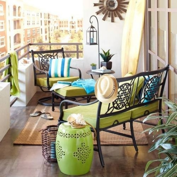 small-balcony-with-wrought-iron-furniture-green-upholstery