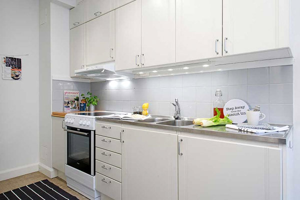 Small-white-kitchen-stainless-steel-countertops-modern-cabinets