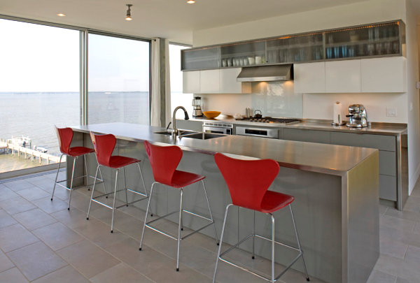 stainless-steel-countertops-fit-in-modern-kitchen-design-red-chairs-accent