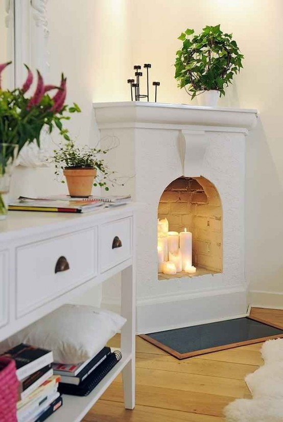 adorable-fireplace-candle-displays-for-any-interior-12-554x826