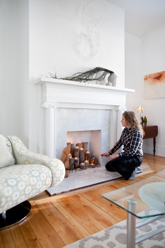 adorable-fireplace-candle-displays-for-any-interior-26-554x831