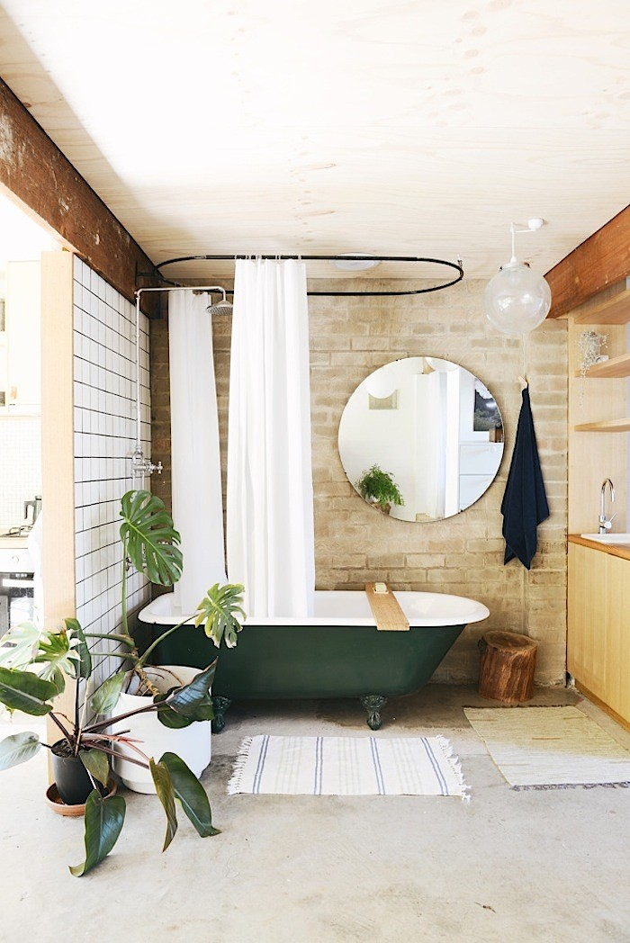 chic-brick-bathroom-with-a-retro-green-bathtub-1