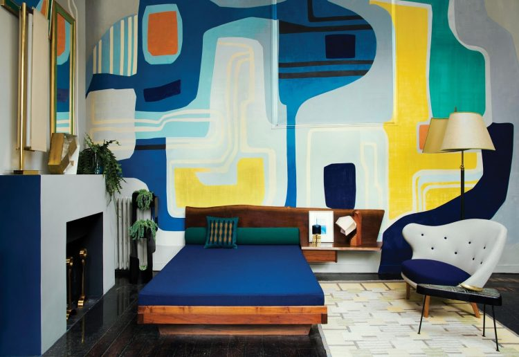 02-The-master-bedroom-has-a-bold-graphic-wall-that-looks-as-an-oversized-art-piece-750x516