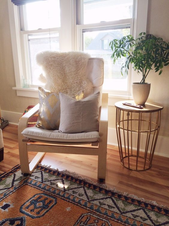 04-off-white-Poang-chair-with-pillows-and-a-fur-cover-for-a-living-room