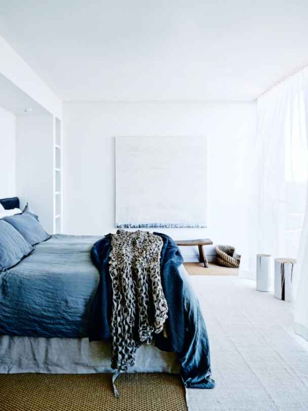 12-The-master-bedroom-is-soothing-in-washed-out-blue-shades