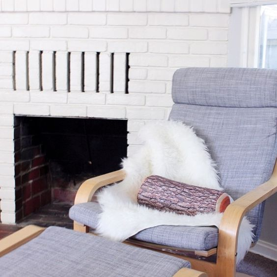 13-grey-Poang-chair-with-faux-sheepskin-and-a-log-pillow