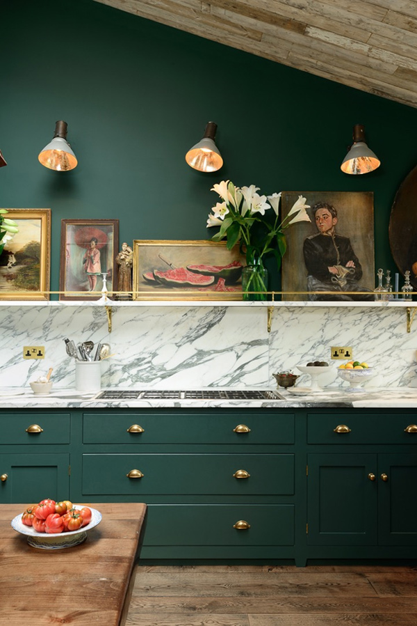04-Antique-artworks-create-an-ambience-and-a-marble-backsplash-contrasts-with-the-dark-green-cabinets