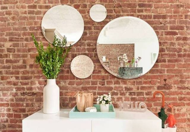 04-The-exposed-brick-wall-gives-the-space-charm-and-character