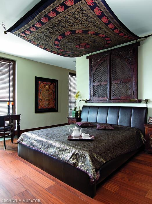 05-An-original-rug-is-hug-as-a-canopy-in-the-bedroom-and-theres-a-Nepal-mandala-on-the-wall