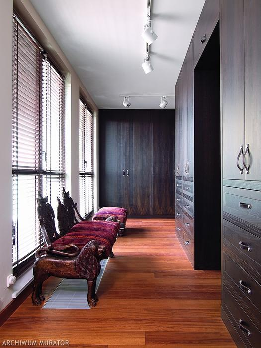 06-The-dressing-room-has-a-lot-of-black-oak-wardrobes-with-leather-pulls