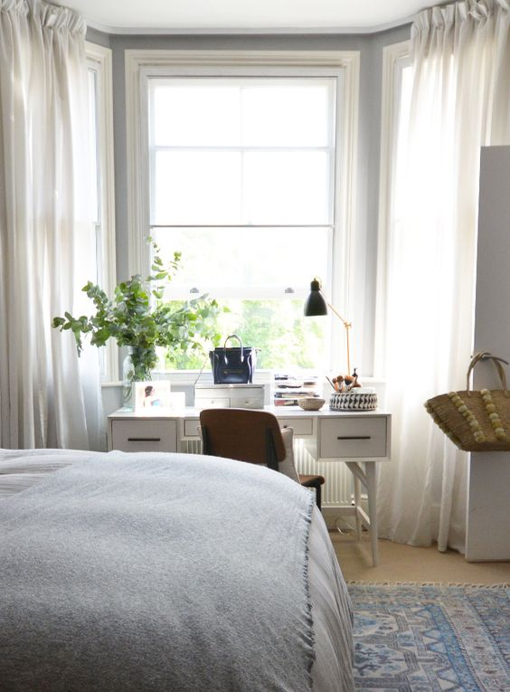 06-serene-bedroom-with-a-white-desk-by-the-window