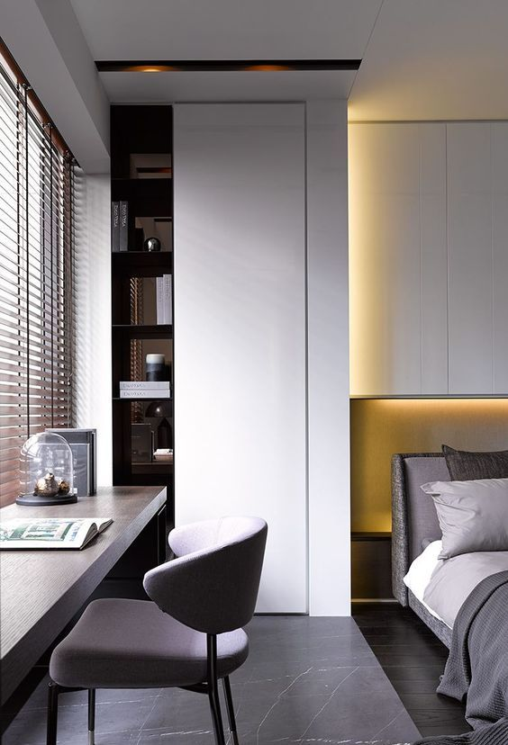 07-minimalist-bedroom-with-a-wooden-desk-and-a-comfy-upholstered-chair