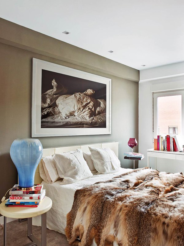 08-The-bedroom-is-cozy-with-an-olive-accent-wall-and-a-gorgeous-fur-bedspread