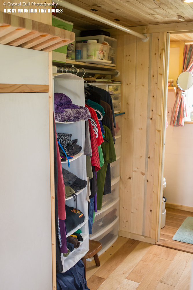 08-Theres-a-compact-walk-in-closet-with-lots-of-shelves-and-cubbies