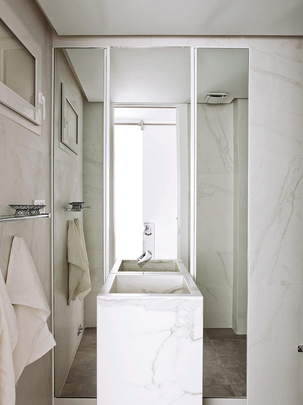 09-The-bathroom-is-small-and-elegant-clad-with-white-marble