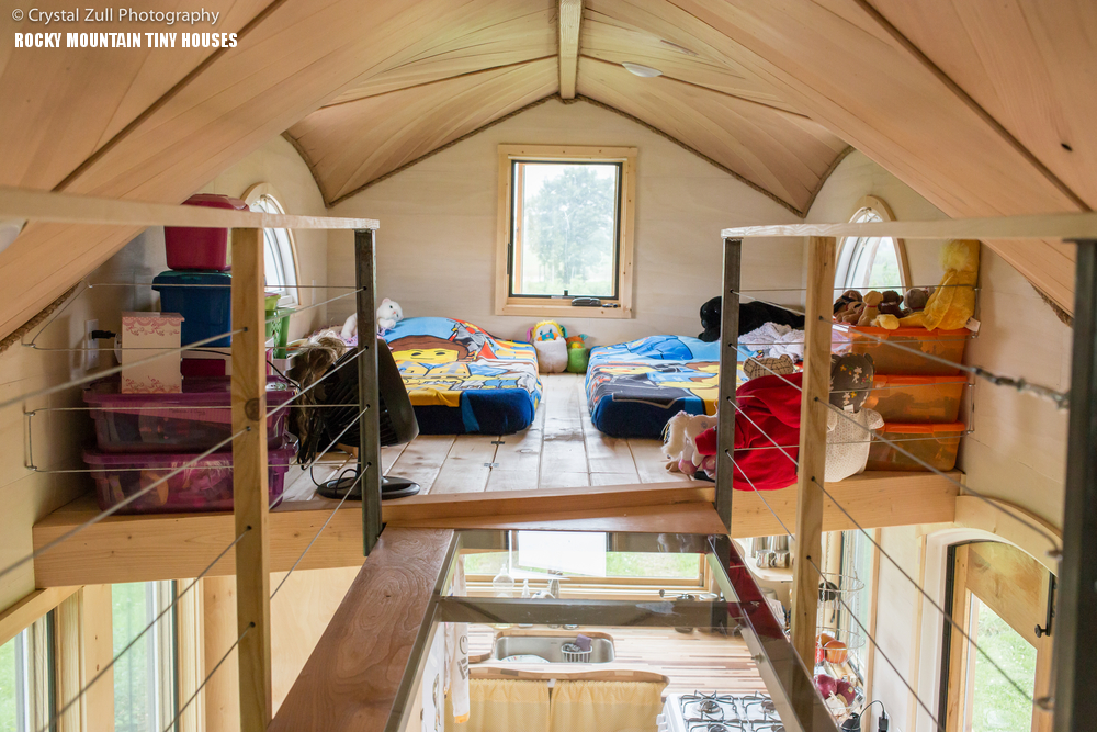 12-Theres-a-shared-kids-bedroom-with-some-open-storage