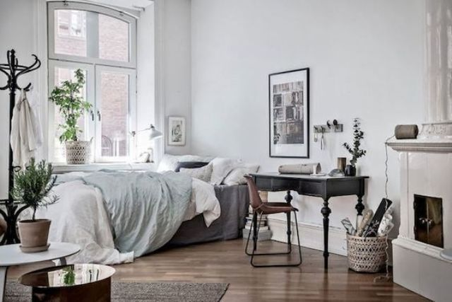 17-Scandinavian-bedroom-with-a-black-desk-by-the-fireplace