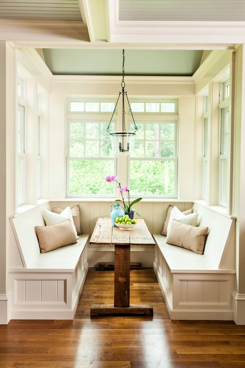 18-cozy-rustic-breakfast-nook-with-a-rough-wood-table