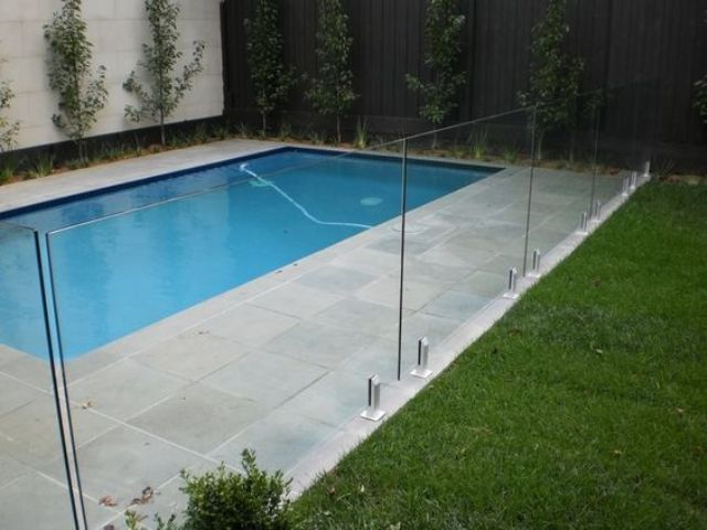 19-stone-pavers-deck-and-a-glass-fence-for-a-pool