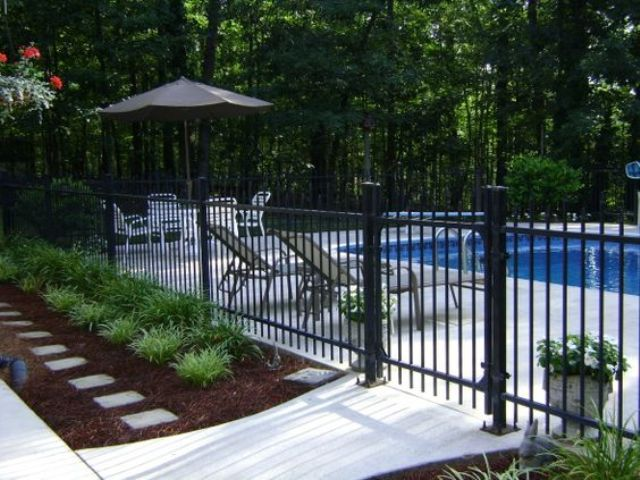 22-blackened-steel-pool-fence-with-flower-beds-around
