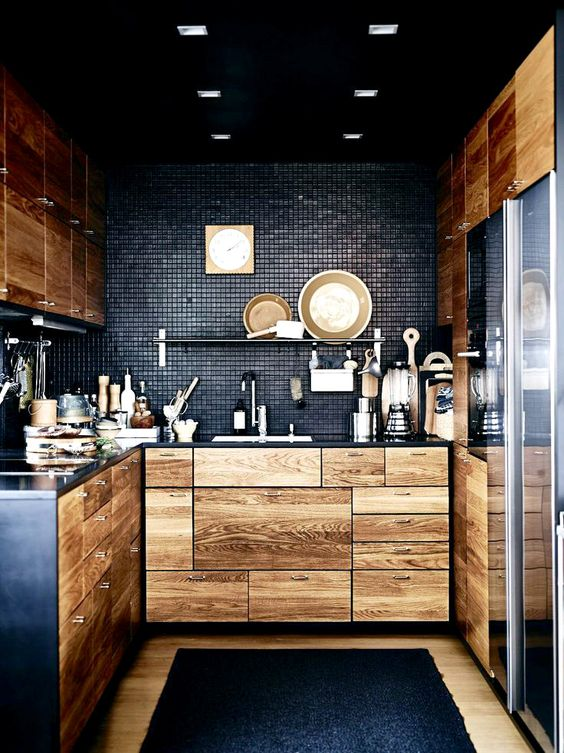 black-kitchen-with-natural-light-colored-wood-cabinetry