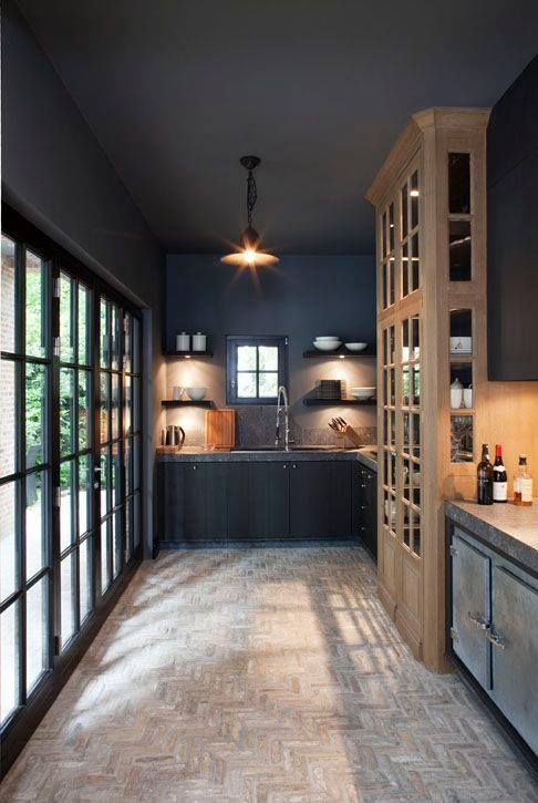 black-kitchen-with-natural-wood-touches-and-granite-countertops
