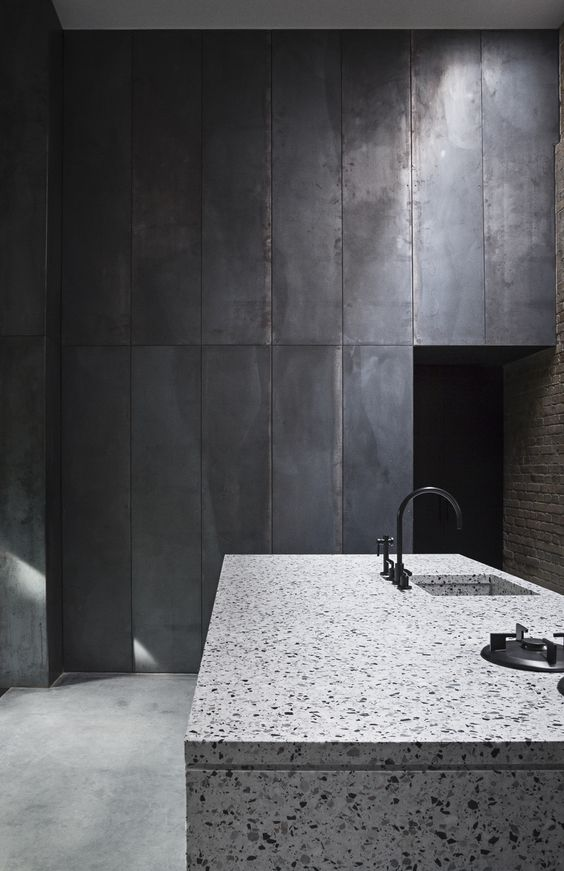 industrial-kitchen-with-metal-cabinets-and-a-stone-island