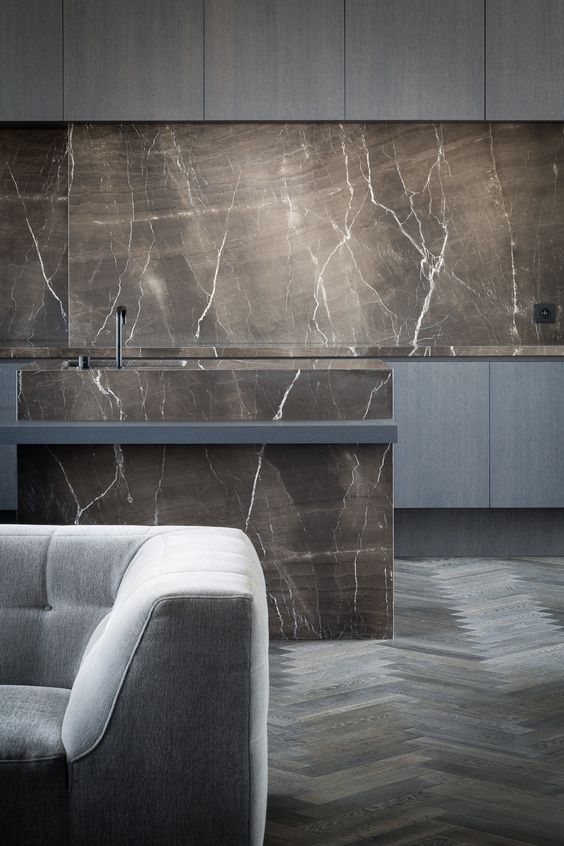 moody-kitchen-with-grey-wooden-cabinetry-and-brown-marble