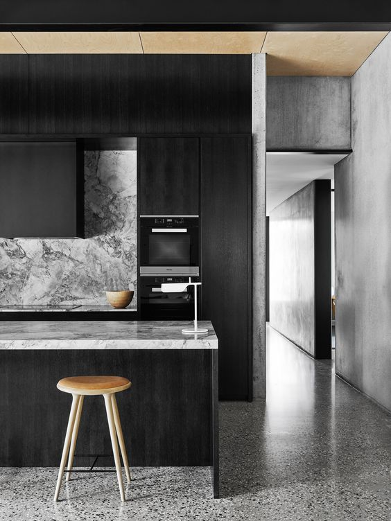 moody-monochrome-kitchen-with-veined-marble-surfaces