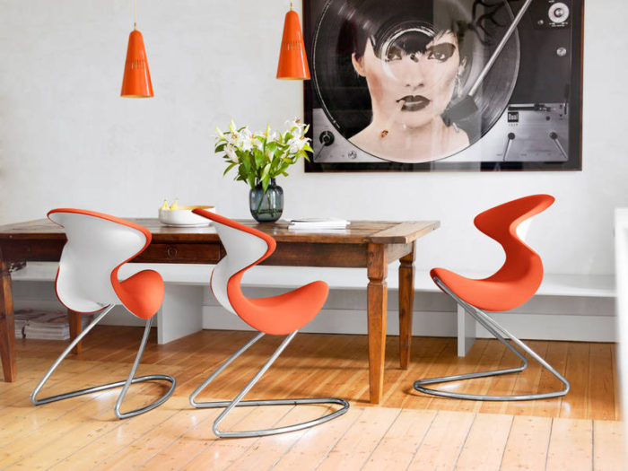 01-This-dining-setting-is-fun-and-the-splash-of-orange-really-adds-a-lot-to-the-room-setting-corresponding-hanging-lights-look-awesome-with-Oyo-chairs