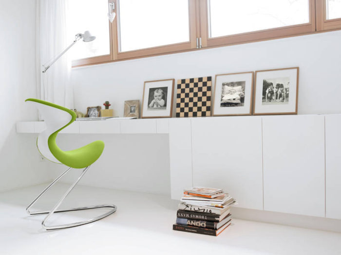 02-This-white-study-nook-by-the-window-is-enlivened-with-the-help-of-just-one-lime-green-Oyo-chair