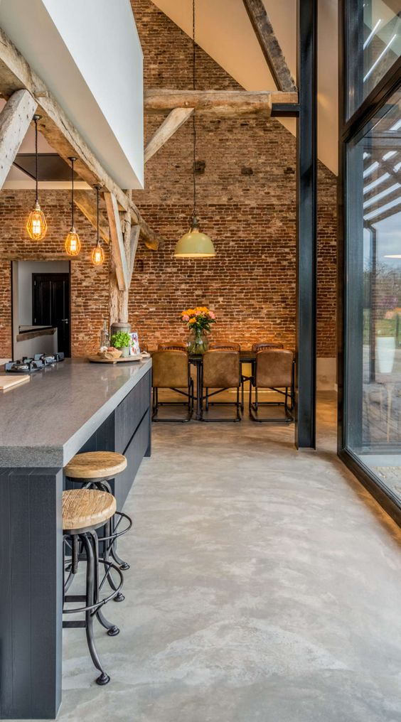 02-concrete-floors-here-perfectly-blend-with-an-industrial-ambience-adding-to-the-mood