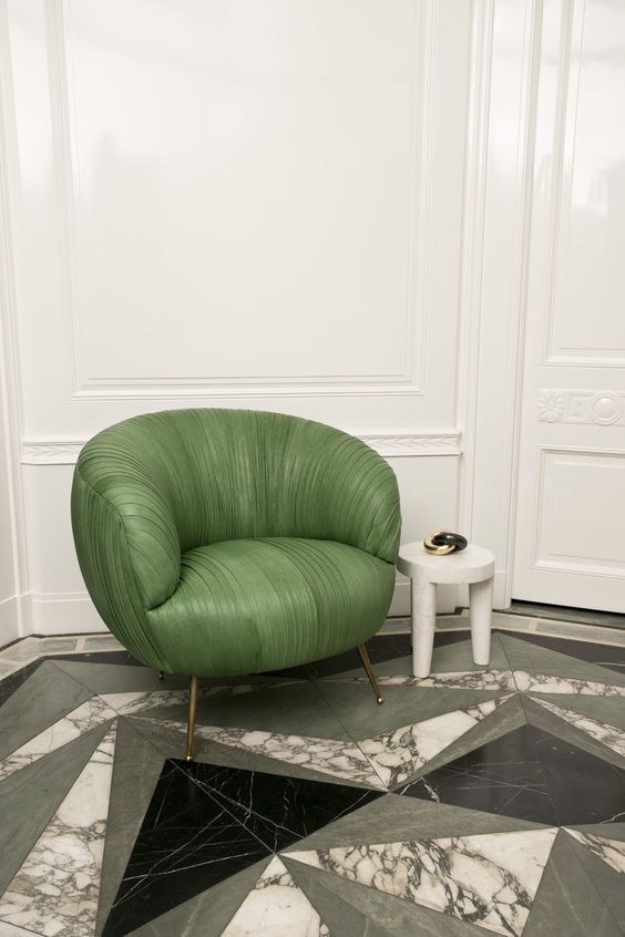 02-geometric-marble-floors-and-a-statement-green-leather-chair